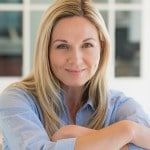 A middle aged woman smiling