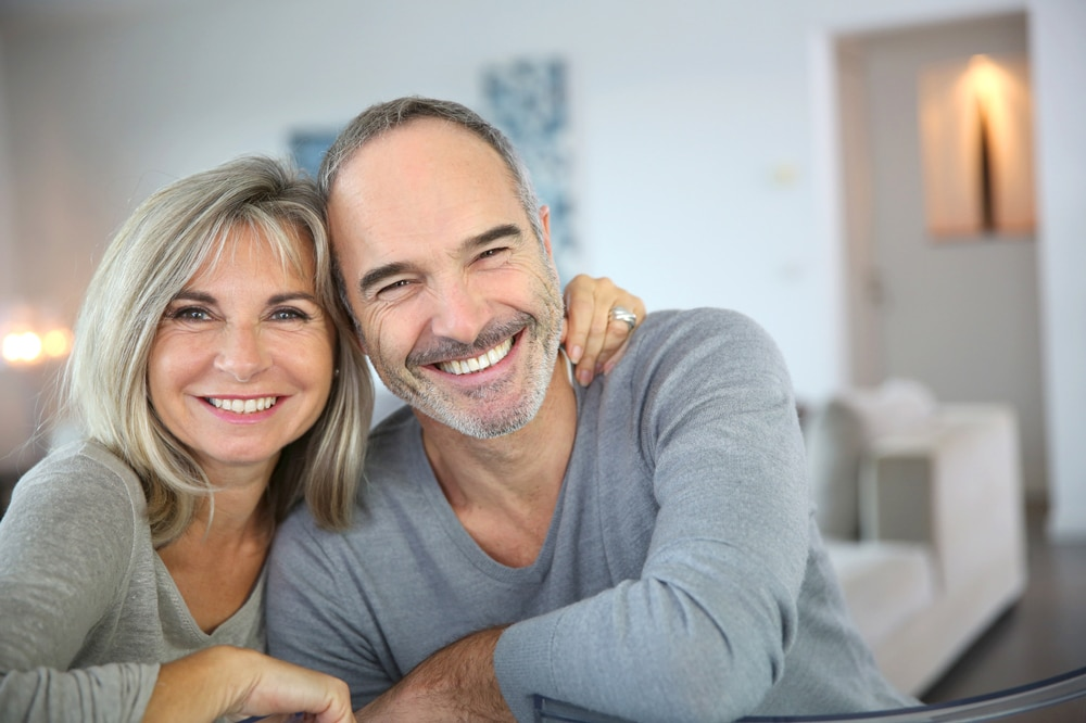 Photo of smiling couple with beautiful smile thanks to Cosmetic Dentistry in Columbus Ohio