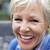 A smiling elderly woman - Dental Implants