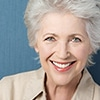 A elderly woman smiling - Gum Disease Treatment