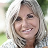 A middle aged woman smiling outside - Oral Cancer Testing