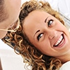 A young woman talking to a dentist - Orthodontics