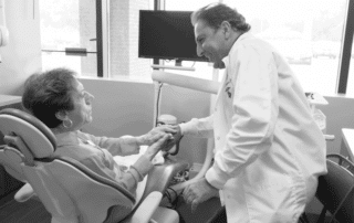 Dr. Michael Firouzian talking with female Patient