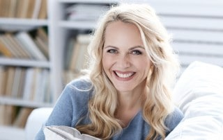 Woman sitting on a couch and smiling
