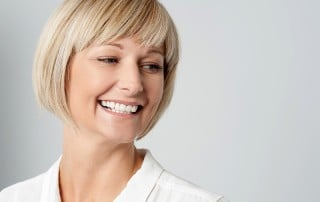 Woman with bob haircut smiling