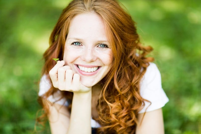 A young red headed woman smiling