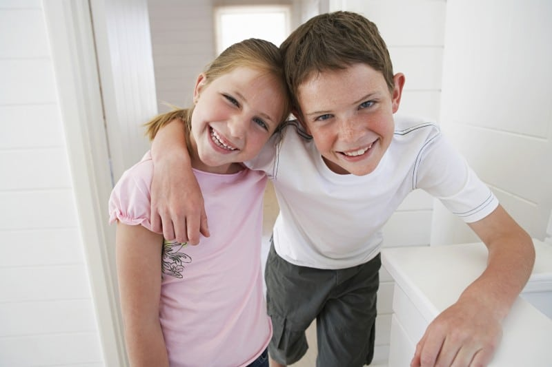 Two young kids smiling