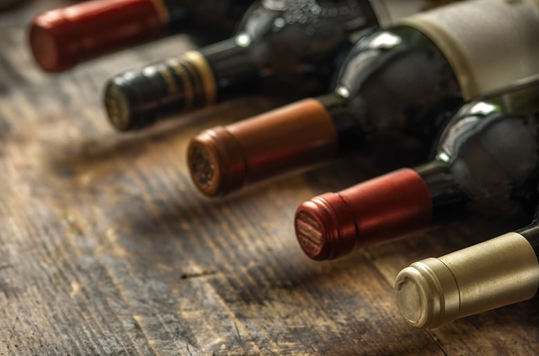A picture of wine bottles lying on their sides, find out about your oral health at Firouzian Dentistry in Columbus, Ohio