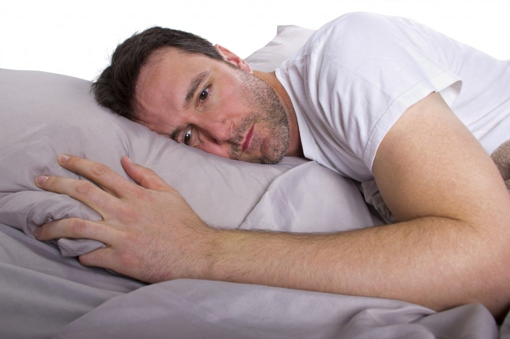 Awake man trying to sleep, a DNA appliance would help him get a better nights sleep.