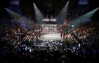 Empty boxing ring surrounded by crowd