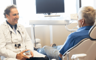 Dr. Michael Firouzian speaking with a patient about treatment options