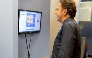 Dr. Michael Firouzian of Columbus views a patient's digital bite