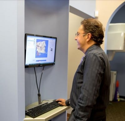 Dr. Michael Firouzian of Columbus views a patient's digital bite