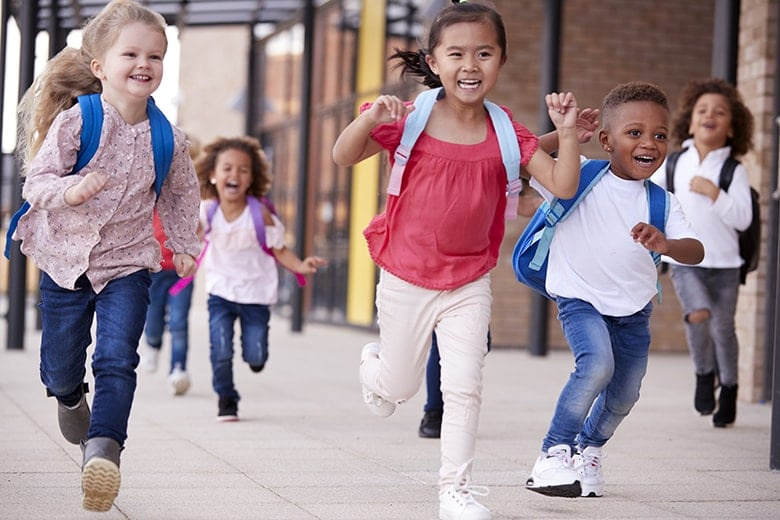 Young elementary school kids leaving class on the last day of the year. These young people will need to manage jaw dysfunction their entire lives. Fortunately, they don't have to do it alone. We can help manage the symptoms and complications of JIA.