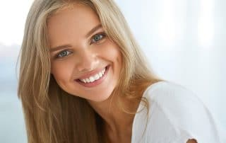 attractive young woman showing off her smile